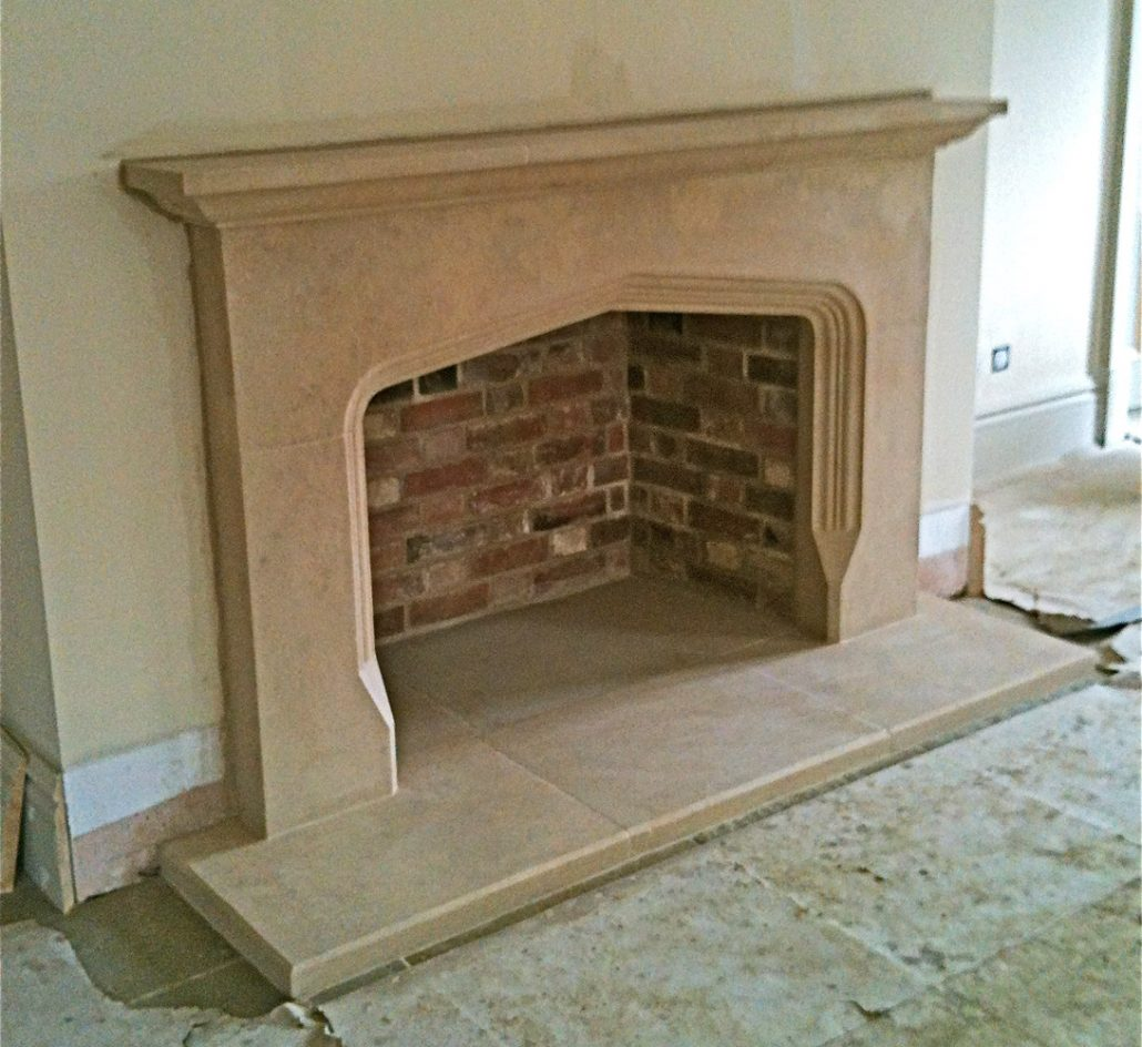 Bathstone Fireplace with moulding running around arch