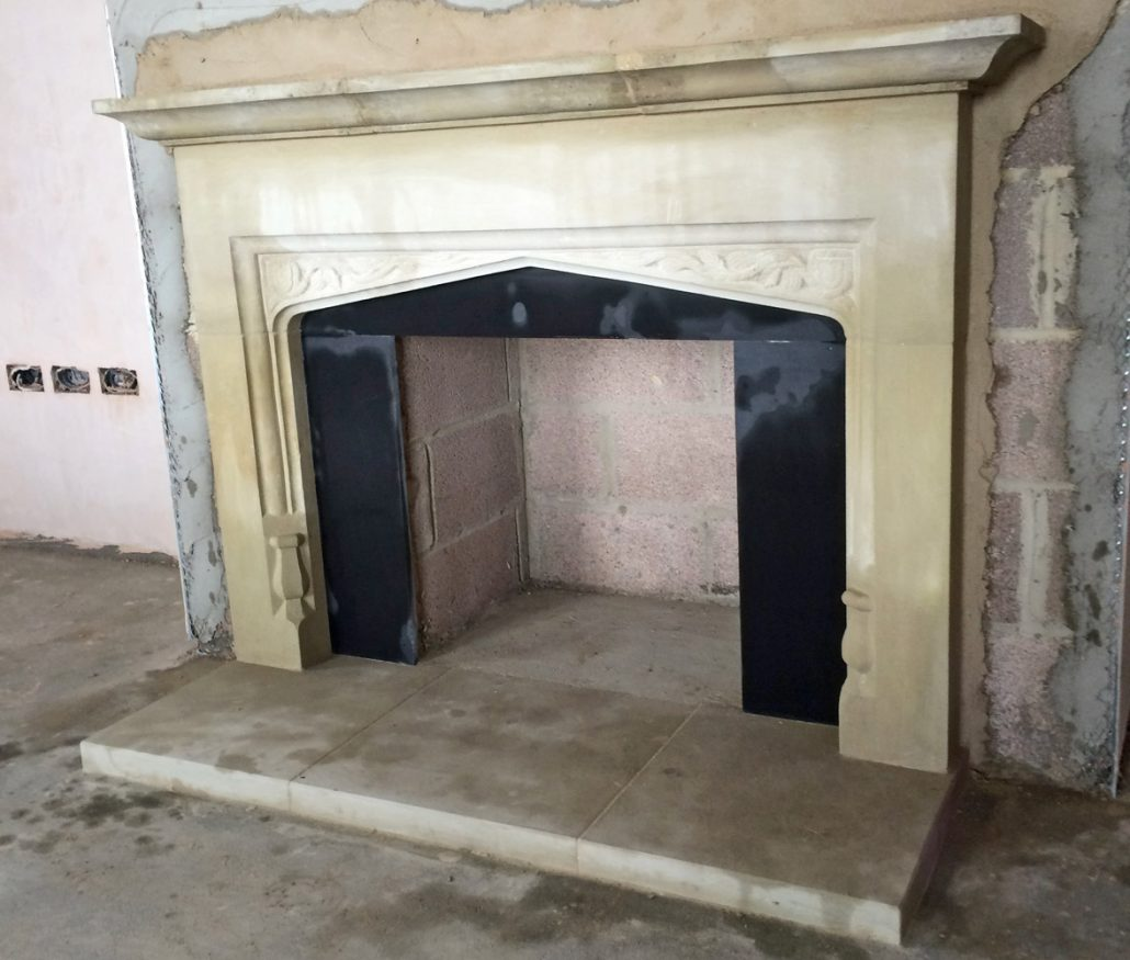 Chicksgrove four centred fireplace with pomegranates