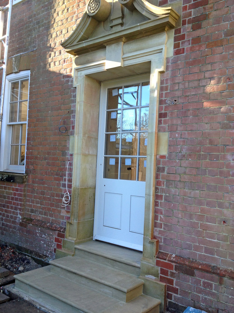 Finished swans Necked Pediment Door Surround with Steps