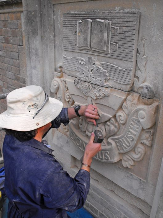 Harry Jonas Carving in leaves on a Schools Bathstone Coat Of Arms