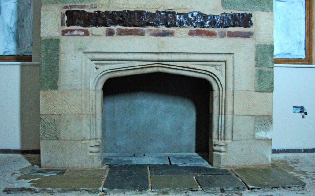 Inset Bathstone Fireplace with Greensand and Bathstone quoins around a modern Chimney breast
