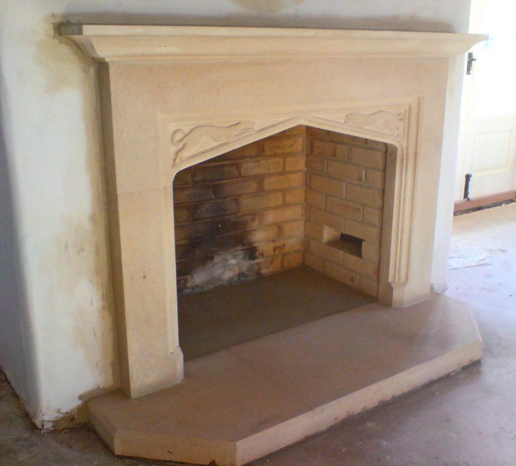 Large Bathstone fireplace with running hounds in spandrels