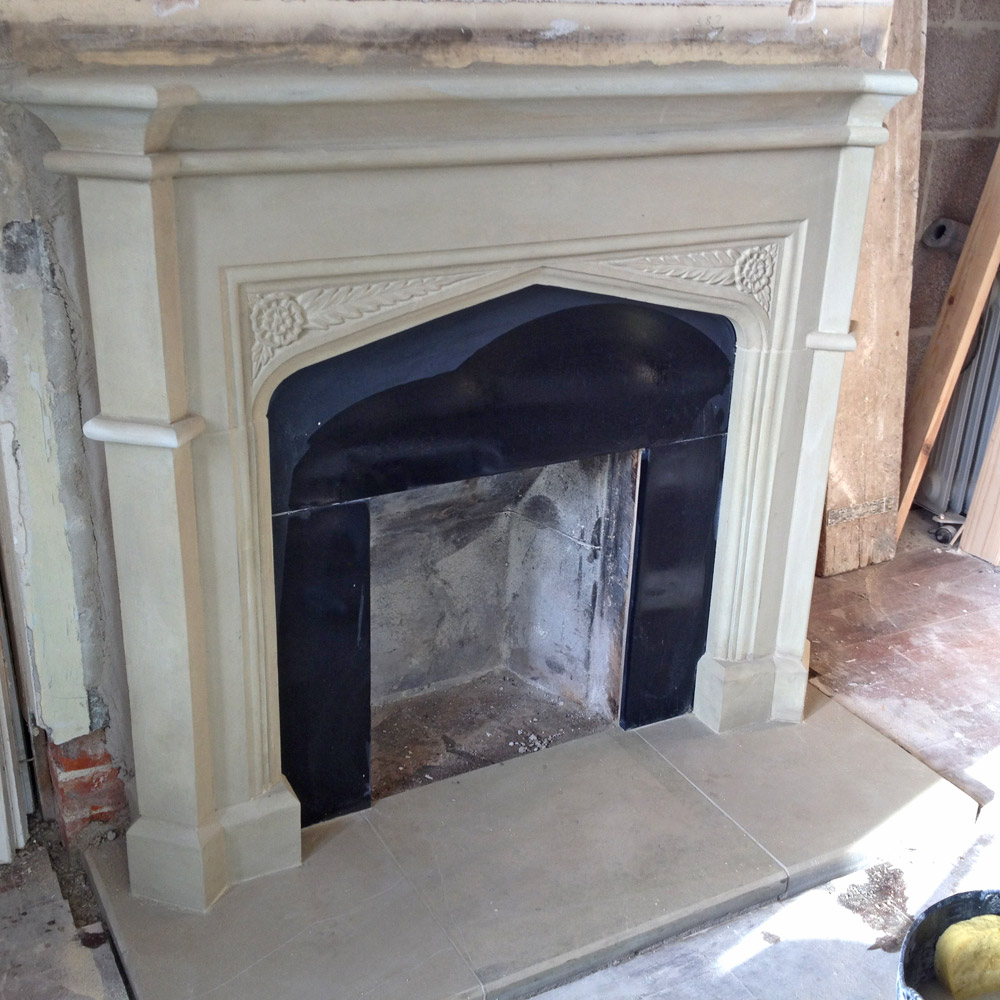 Pillaster sided Fireplace with roses in spandrels Chicksgrove stone