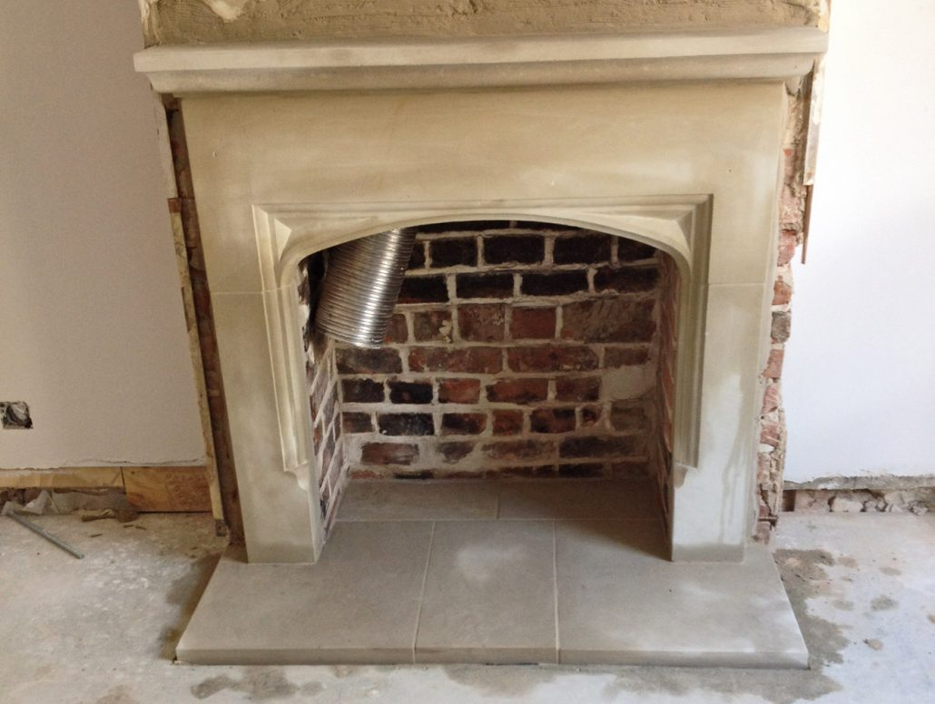 Smaller Chicksgrove Fireplace three centred head waiting for a log burner