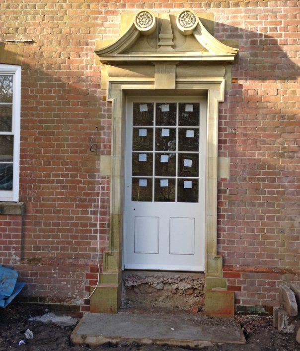 Swans Necked Pediment Door Surround glazed and waiting for Chicksgrove Hard Bed steps